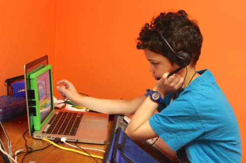 Gabriel controls the VGo remotely from his home.